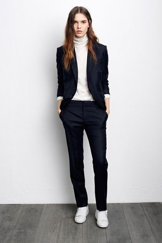 Try pairing a navy blazer jacket with navy dress pants and you'll look like a total babe. For footwear go down the casual route with white low top sneakers.