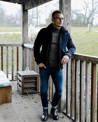 How to wear: navy wool bomber jacket, charcoal turtleneck, blue skinny jeans, black leather chelsea boots