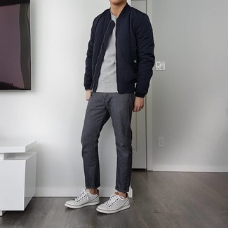 Charcoal Jeans Spring Outfits For Men: If you don't like putting too much effort into your getups, rock a navy quilted bomber jacket with charcoal jeans. Let your styling skills really shine by complementing this getup with white leather low top sneakers. And if you're looking for an awesome transition ensemble, this one is great.