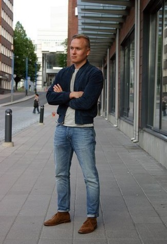 How to Wear Light Blue Jeans For Men: When the setting allows casual dressing, make a navy bomber jacket and light blue jeans your outfit choice. When it comes to shoes, this outfit is rounded off perfectly with brown suede desert boots.
