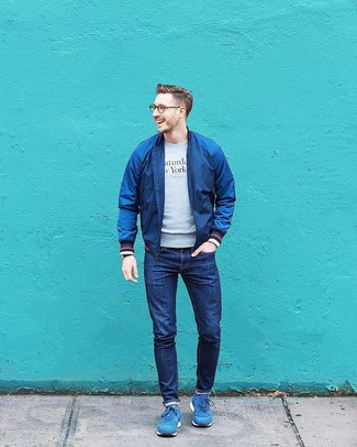 How to Wear Blue Athletic Shoes For Men: This ensemble with a navy bomber jacket and navy jeans isn't hard to create and is open to more sartorial experimentation. For a more laid-back aesthetic, complement your look with a pair of blue athletic shoes.