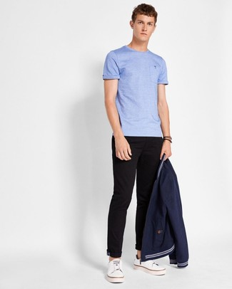 How to wear: navy bomber jacket, light blue crew-neck t-shirt, black chinos, white leather low top sneakers