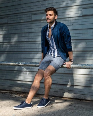 How to wear: navy bomber jacket, navy and white vertical striped short sleeve shirt, blue linen shorts, navy leather low top sneakers