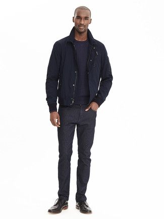 How to wear: navy bomber jacket, navy crew-neck sweater, black jeans, black leather brogue boots