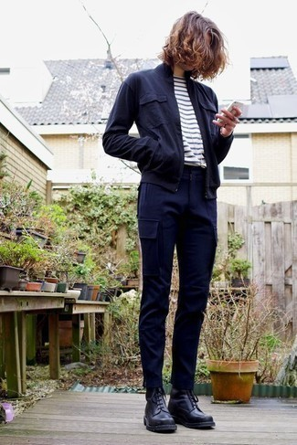 How to Wear Navy Cargo Pants: Make a navy bomber jacket and navy cargo pants your outfit choice to achieve new heights in your personal style. To give your overall look a more polished aesthetic, complement your outfit with a pair of black leather casual boots. Those who are curious how to wear modern casual outfits as you drift through your 20s, you have your answer.