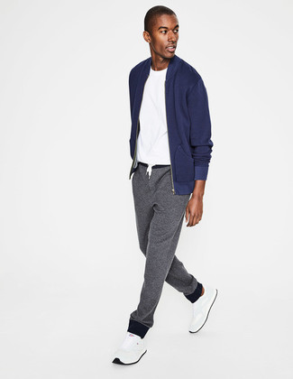 How to wear: navy bomber jacket, white crew-neck t-shirt, grey sweatpants, white athletic shoes