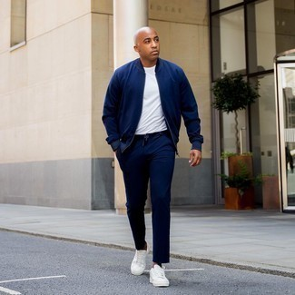 Men's Outfits 2020: If you're hunting for a casual but also on-trend ensemble, rock a navy bomber jacket with navy chinos. If you wish to immediately dial down this look with shoes, why not introduce a pair of white canvas low top sneakers to the equation?