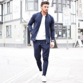 How to Wear White Plimsolls In Your 30s For Men: A navy bomber jacket and navy sweatpants? This is an easy-to-achieve outfit that any gent could wear a variation of on a day-to-day basis. Our favorite of a countless number of ways to complement this ensemble is with white plimsolls.