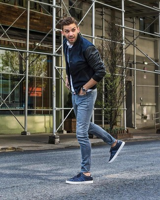 How to Wear Navy Low Top Sneakers For Men: Pair a navy bomber jacket with light blue jeans for a casual look with a contemporary spin. Choose a pair of navy low top sneakers and ta-da: this ensemble is complete.