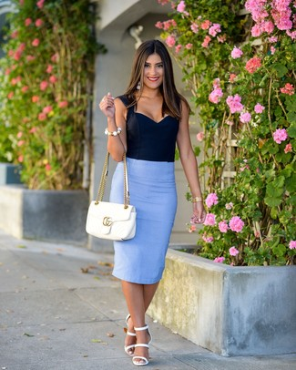 How to wear: navy bustier top, light blue pencil skirt, white leather heeled sandals, white quilted leather satchel bag
