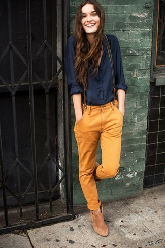 How to wear: navy button down blouse, tobacco chinos, tan suede ankle boots, olive suspenders