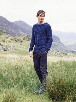 How to wear: navy cable sweater, charcoal sweatpants, black leather casual boots, navy beanie
