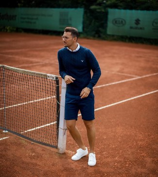 How to Wear a Navy Cable Sweater For Men: A navy cable sweater and navy shorts are the ideal way to introduce extra cool into your casual wardrobe. Let your outfit coordination savvy truly shine by complementing your look with white low top sneakers.