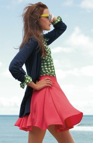 If you're a fan of classic pairings, then you'll like this combination of a navy blue cardigan and a red skater skirt.