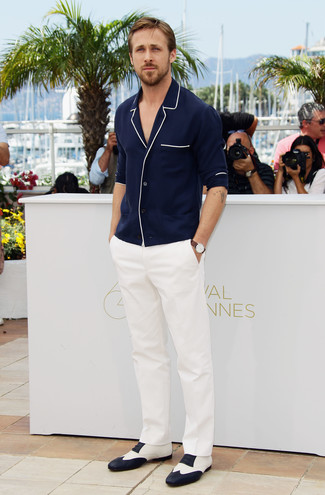 Ryan Gosling wearing Navy Cardigan, White Dress Pants, White and Black Leather Oxford Shoes, Brown Leather Watch