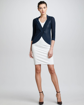 Dress in a cardigan and a white fitted dress if you're going for a neat, stylish look. This outfit is complemented perfectly with dark brown leather pumps.