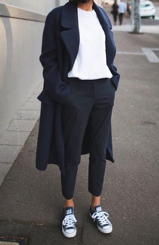 A navy coat and black dress pants teamed together are a total eye candy for those who appreciate classy styles. Marc by Marc Jacobs Navy Satin Laceless Cute Kicks Sneakers will add some edge to an otherwise classic look. This is a foolproof option for an easy-to-transition getup.