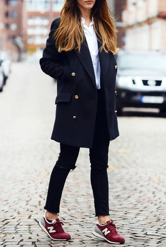 A navy coat and black ripped slim jeans is a wonderful combination to impress your crush on a date night. Dark red low top sneakers are the right shoes here to get you noticed.