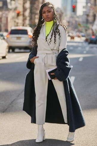 How to wear: navy fluffy coat, yellow turtleneck, grey jumpsuit, white leather ankle boots