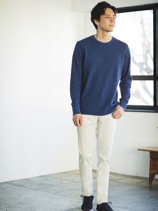 How to wear: navy crew-neck sweater, beige chinos, black suede low top sneakers