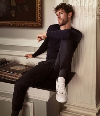 How to wear: navy crew-neck sweater, black chinos, white leather low top sneakers, black socks