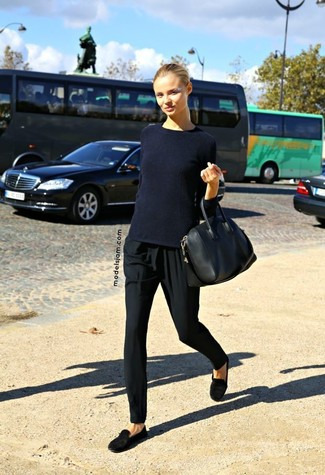 A dark blue crew-neck pullover and black pajama pants are great essentials to incorporate into your current wardrobe. A cool pair of black suede loafers is an easy way to upgrade your look. If you're already bored of your transitional season fashion options, this look just might be the inspiration you are searching for.