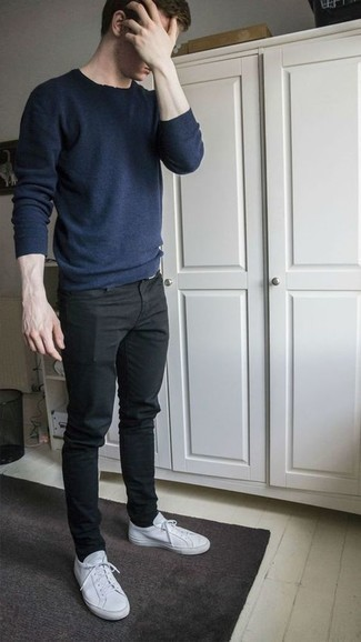 Black Jeans Spring Outfits For Men: Uber stylish, this relaxed casual combo of a navy crew-neck sweater and black jeans will provide you with variety. The whole look comes together if you complete your look with white canvas low top sneakers. Keep this combo in your front hall wardrobe come warmer weather, and we guarantee you'll save a lot of time getting ready on more than one occasion.