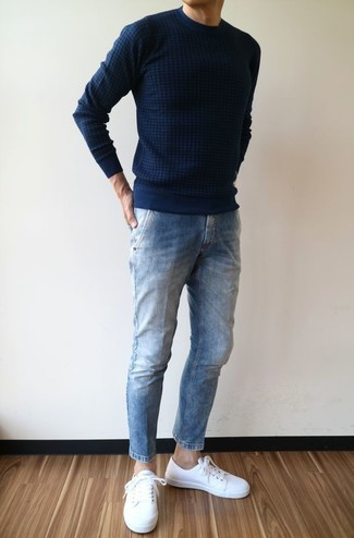 How to wear: navy crew-neck sweater, blue jeans, white leather low top sneakers