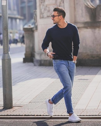 How to wear: navy crew-neck sweater, blue jeans, white low top sneakers