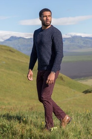 Bracelet Outfits For Men: Go for a straightforward but at the same time cool and casual ensemble by putting together a navy crew-neck sweater and a bracelet. To bring a bit of fanciness to this look, introduce a pair of brown leather casual boots to your look.
