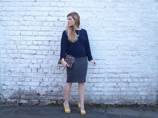 Stand out among other stylish civilians in a navy crew-neck sweater and a charcoal pencil skirt. Choose a pair of yellow leather pumps to va-va-voom your outfit. You can bet this combination is great come fall.