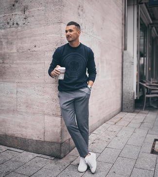 How to wear: navy print crew-neck sweater, grey dress pants, white low top sneakers, silver watch