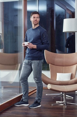 How to Wear a Navy Crew-neck Sweater For Men: Want to inject your wardrobe with some fashion-forward cool? Rock a navy crew-neck sweater with grey jeans. A pair of navy athletic shoes effortlessly bumps up the wow factor of your outfit.