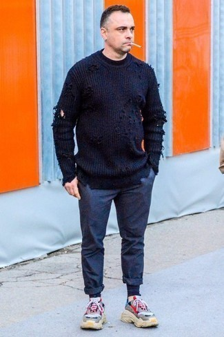 How to Wear a Navy Crew-neck Sweater For Men: This combination of a navy crew-neck sweater and navy chinos is proof that a safe casual outfit can still be really interesting. Here's how to dress down this look: grey athletic shoes.