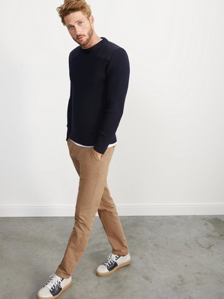 Men's Looks & Outfits: What To Wear In 2020: To pull together an off-duty outfit with a fashionable spin, you can opt for a navy crew-neck sweater and khaki chinos. Our favorite of an endless number of ways to complete this look is with a pair of white and navy leather low top sneakers.