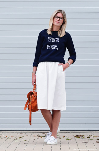 How to wear: navy print crew-neck sweater, white pleated midi skirt, white leather low top sneakers, orange leather satchel bag