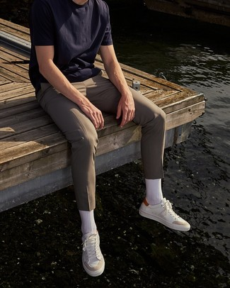 How to Wear a Navy Crew-neck T-shirt For Men: If you gravitate towards casual style, why not take this pairing of a navy crew-neck t-shirt and beige chinos for a walk? If you're not sure how to finish, a pair of white leather low top sneakers is a savvy idea.