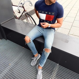 How to wear: navy print crew-neck t-shirt, light blue ripped skinny jeans, grey athletic shoes, silver watch
