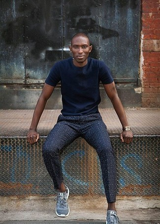 How to Wear Navy Print Chinos: This casual pairing of a navy crew-neck t-shirt and navy print chinos is a goofproof option when you need to look neat and relaxed in a flash. Get a little creative when it comes to shoes and complement your ensemble with blue athletic shoes.