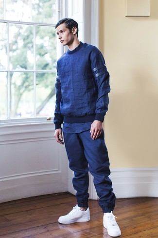 Navy Track Suit Outfits For Men: For an urban ensemble without the need to sacrifice on functionality, we love this combo of a navy track suit and a navy crew-neck t-shirt. If you wish to immediately perk up this look with a pair of shoes, complete this ensemble with white leather low top sneakers.