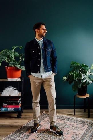 How to Wear a Navy Denim Jacket For Men: This laid-back combo of a navy denim jacket and khaki chinos is super easy to pull together in no time, helping you look awesome and ready for anything without spending too much time digging through your wardrobe. For a more relaxed twist, introduce a pair of multi colored athletic shoes to the mix.