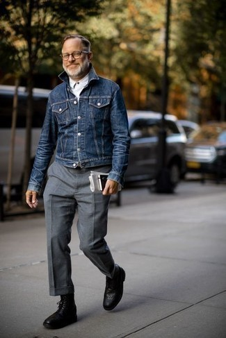 How to Wear a Navy Denim Jacket For Men: The sartorial collection of any gentleman should always include such wardrobe heroes as a navy denim jacket and grey wool dress pants. Dial down the formality of this outfit by slipping into black leather brogue boots.