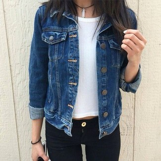 How to wear: navy denim jacket, white short sleeve sweater, black skinny jeans