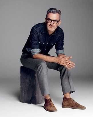 How to Wear a Denim Shirt For Men: Why not opt for a denim shirt and grey chinos? Both of these items are totally practical and will look good worn together. Add brown suede desert boots to the mix and the whole outfit will come together quite nicely.