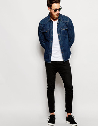 How To Wear Black Jeans With a Navy Denim Shirt For Men: A navy denim shirt and black jeans are among the crucial elements in any modern gentleman's versatile casual sartorial collection. If you're clueless about how to finish, add a pair of black low top sneakers.