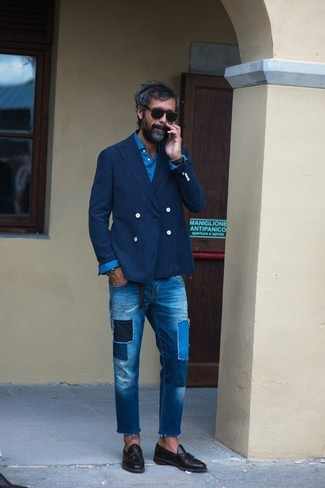 How to wear: navy double breasted blazer, blue long sleeve shirt, blue patchwork jeans, black leather tassel loafers