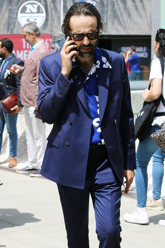 How to wear: navy double breasted blazer, blue print short sleeve shirt, navy dress pants, dark brown sunglasses