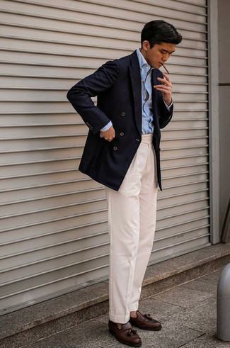Navy Double Breasted Blazer Outfits For Men: A navy double breasted blazer and beige dress pants are an extra stylish ensemble for any gentleman to try. Inject a more relaxed aesthetic into your outfit by wearing dark brown leather tassel loafers.