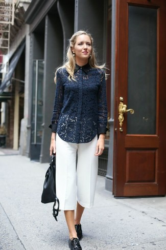 Marry a dark blue lace classic shirt with a backpack for incredibly stylish attire. A pair of black leather oxfords looks very fitting here. This look is absolutely great to welcome spring.