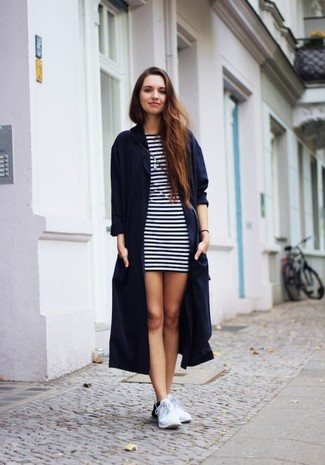 How to wear: navy duster coat, white and navy horizontal striped casual dress, white athletic shoes